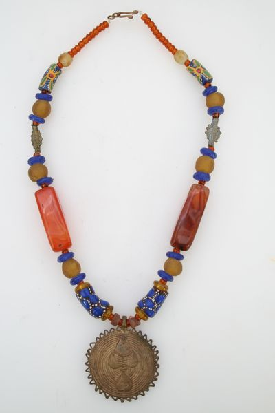 71b90cc02f34 Artesania de Africa. Bisutería colgante bronce. pez adinkra